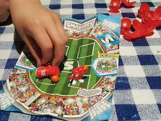playing smashers game on paper football pitch