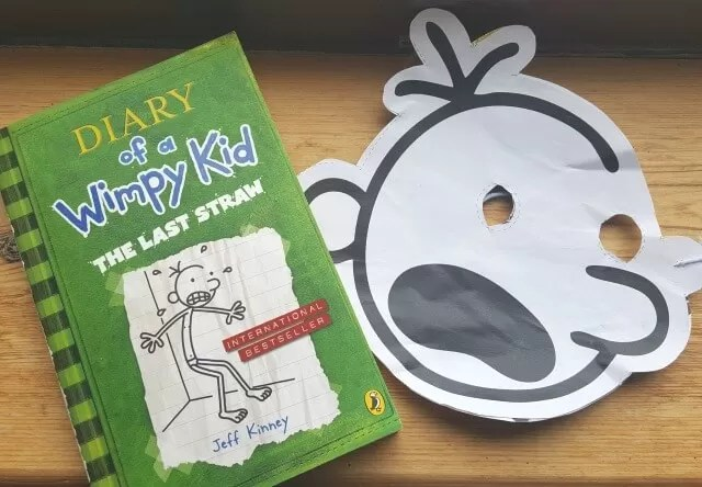 diary of a wimpy kid mask and book