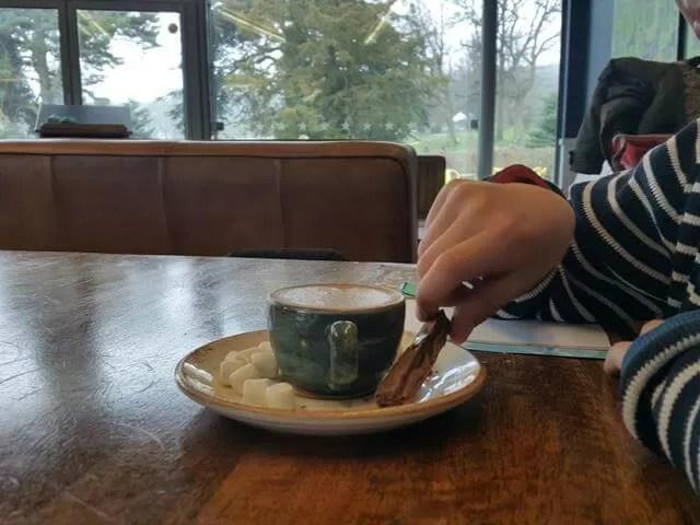 enjoying babyccino at Trentham cafe