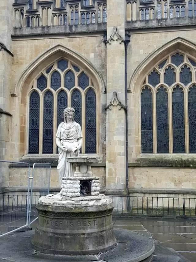 statue outside bath abbey
