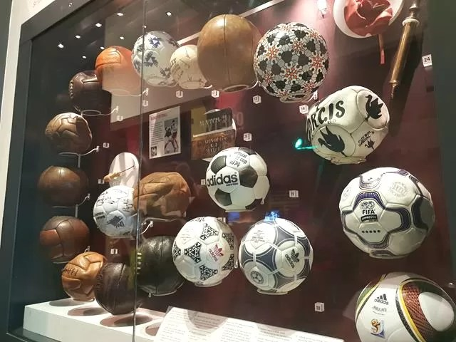 old footballs on display
