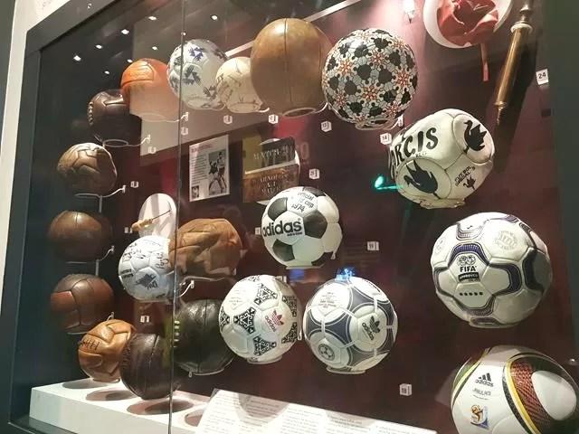 old footballs on display
