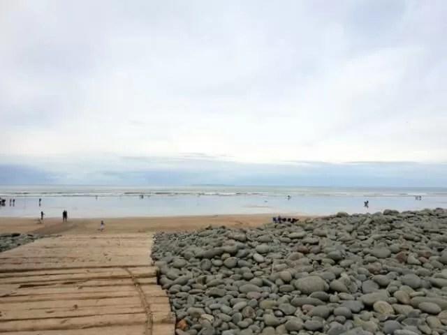 over the pebble ridge to the beach