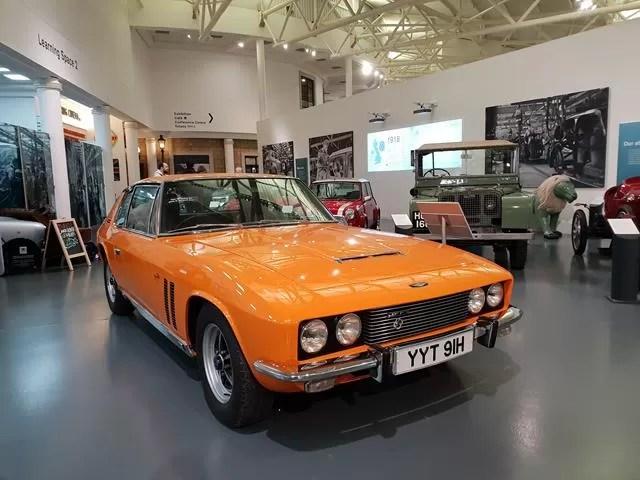 orange car in the museum