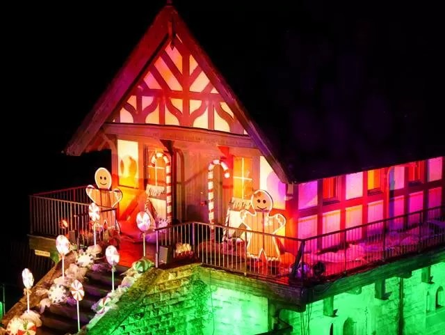 gingerbread style house lit up