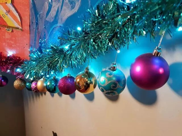 multicolour baubles hanging on the wall