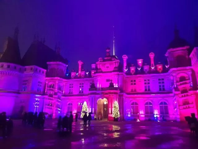 pink and purple lit up front of waddesdon