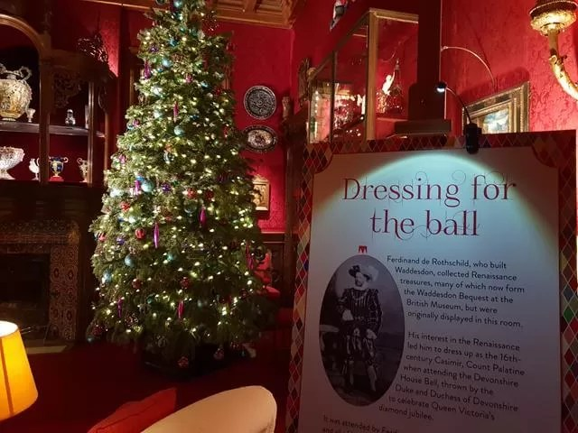 ready for the ball sign by smoking room christmas tree