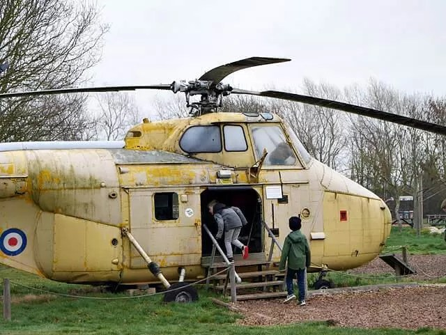 old tellow helicopter and children playing