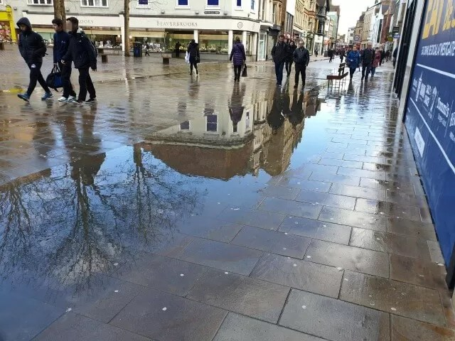 reflections of Oxford shopping street and trees
