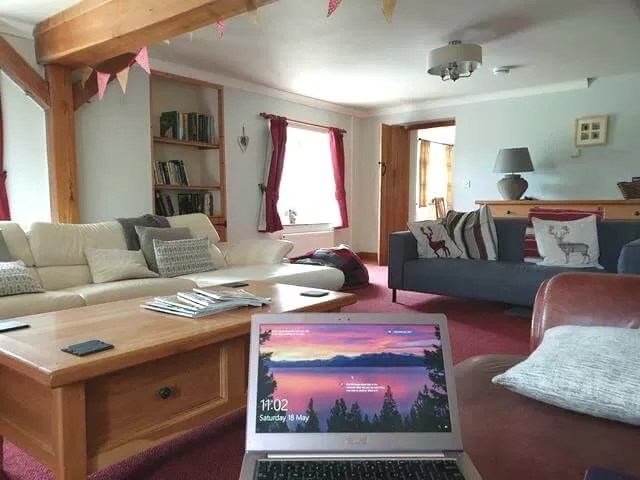 relaxing blogging in farmhouse living room