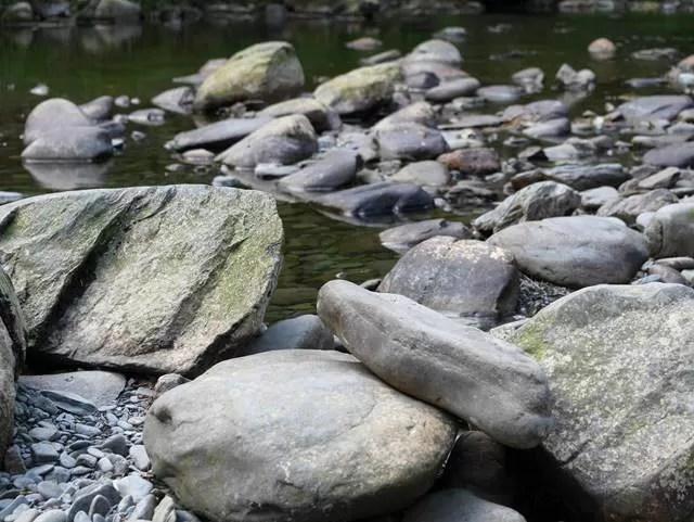 rocks and stones alongside river