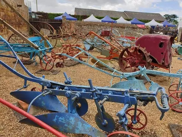 blue and red farm machinery