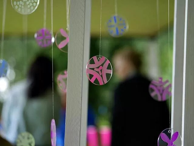 finished decorated perspex discs hanging