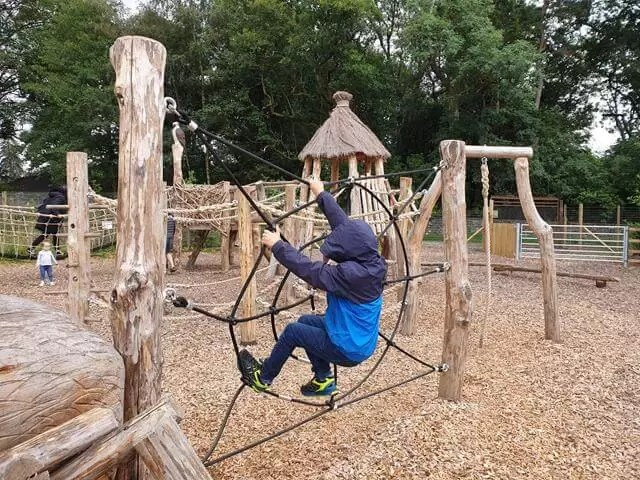 doing obstacles at adventure playground