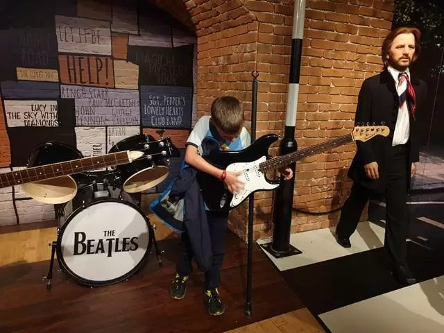 playing guitar for the beatles