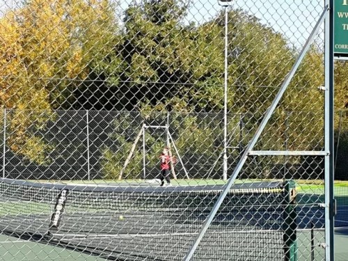 playing tennis through the netting