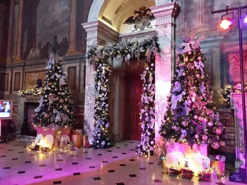 Blenheim palace hall decorated for christmas with 2 trees