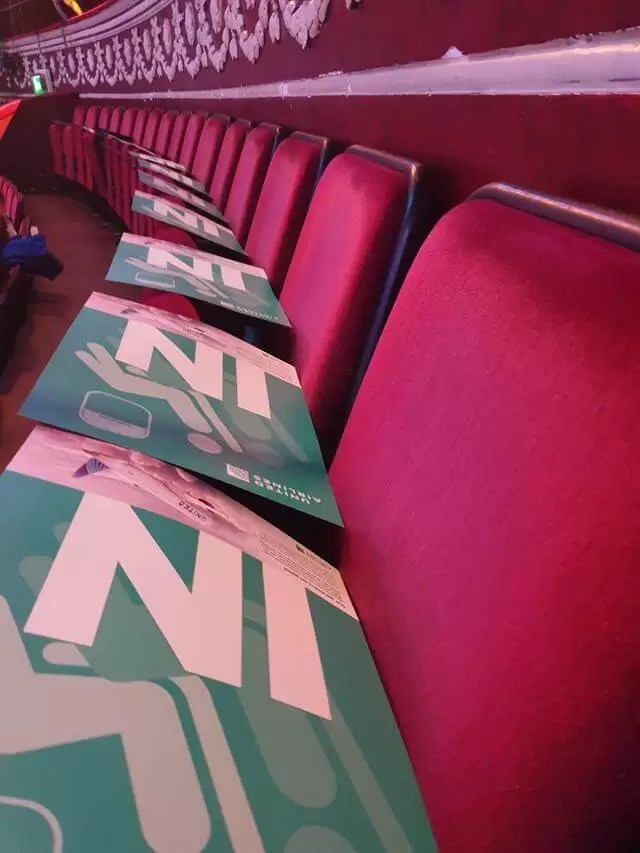 in posters on seats at the royal albert hall
