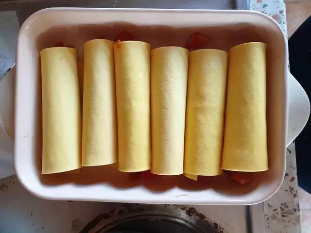 rolled up fresh lasagne to make cannelloi