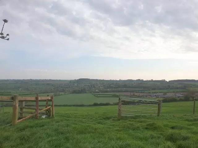 beatiful sky through an open countryside gate