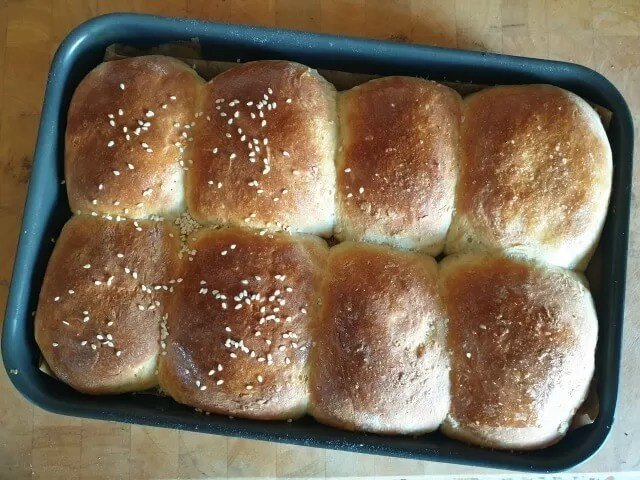 sesame and salt topped dinner rolls