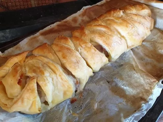 cooked sausage plait just out of the oven