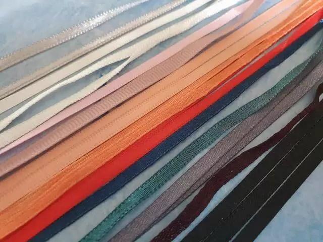 rows of ribbons taken from clothing ribbong loops