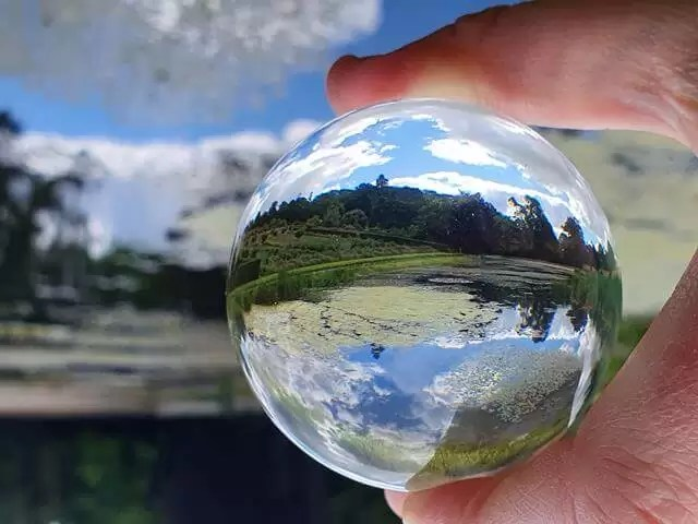 lensball with mirror lake sky reflection in