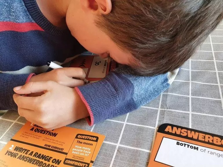 hiding his answers for board game confident