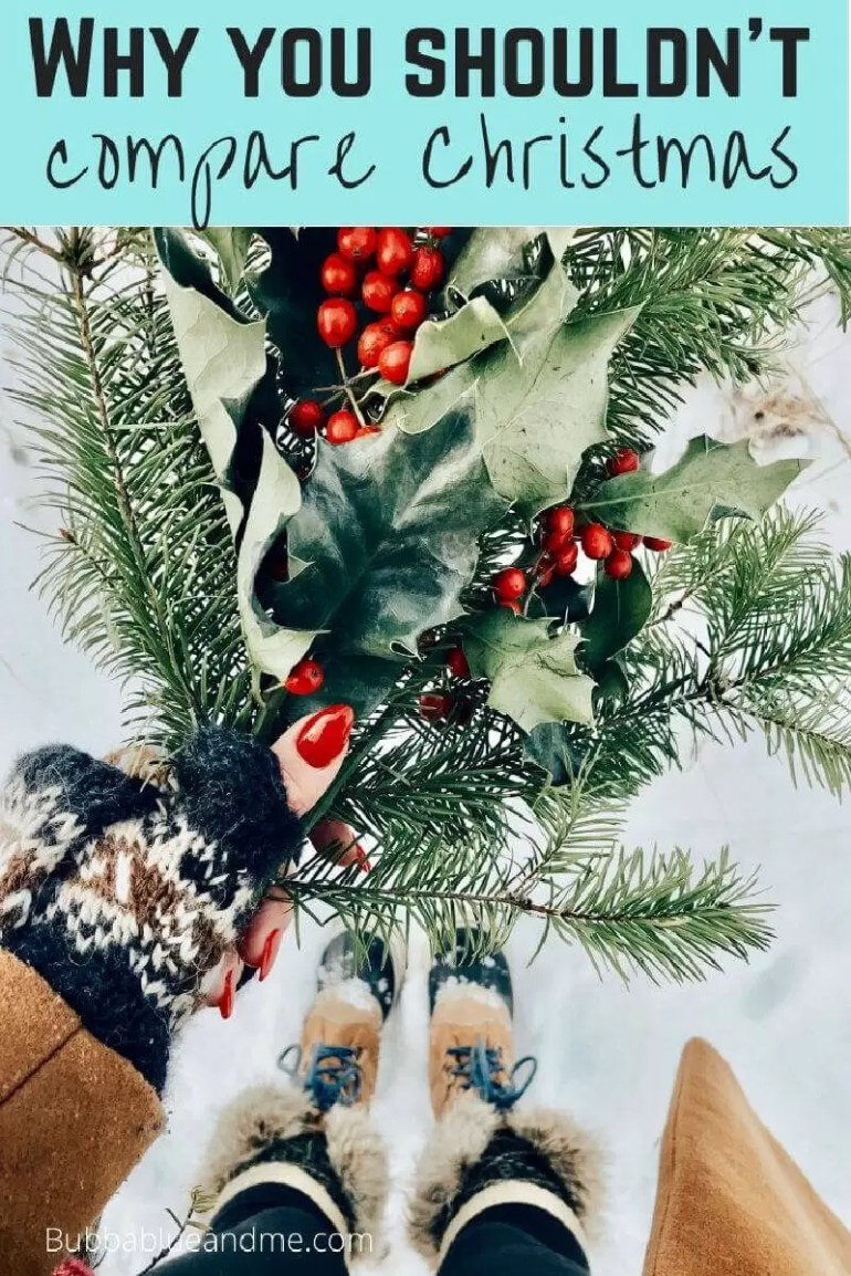 Why you shouldn't compare christmases. Hand holding bunch of holly, and firs