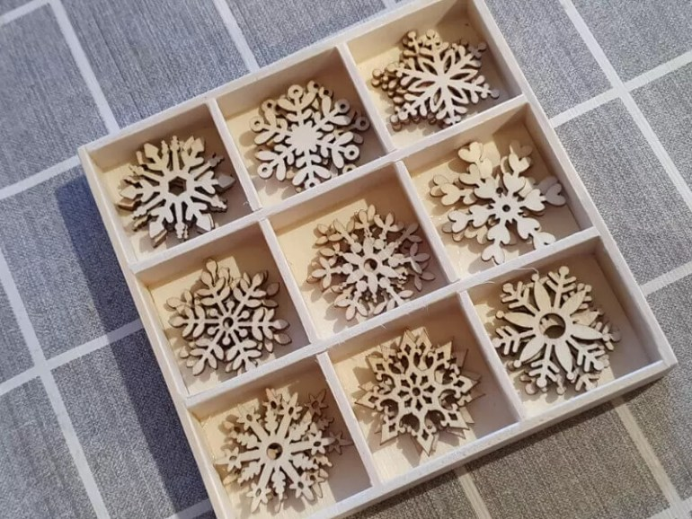 wooden snowflakes for crafts in a box