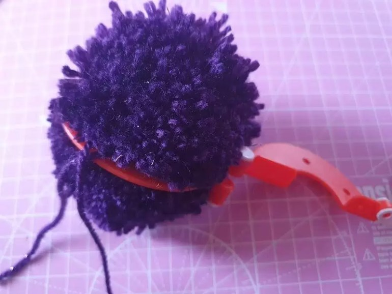 opening up a pom pom maker once yarn is cut