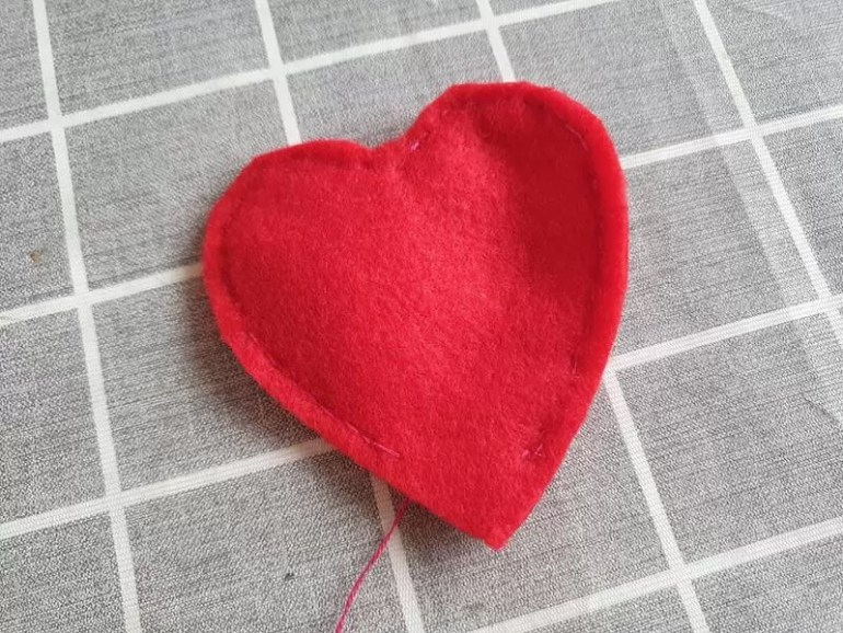 cut out sewn red heart shape