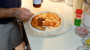 Adding Pizza Sauce to the Dough