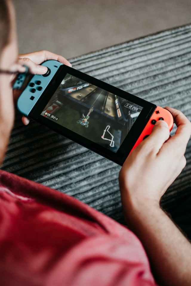 A man is playing games on his Nintendo Switch