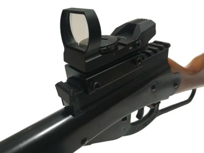 Closeup of red dot scope mounted on the daisy buck 105 using the little buck rail