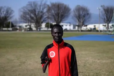 The broker's paralympic 100 and 200 meters South Sudan, Michael Machiek Ting Kutjang, poses for a photo after an interview with AFP in Maebashi. - The deferment of the Olympic Games for Tokyo 2020 was a hard blow for many athletes, but a team of sprinters of south Sudan q