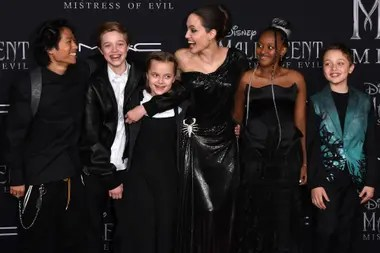 Angelina next to five of their six children: Pax, Shiloh, Vivienne, Zahara and Knox