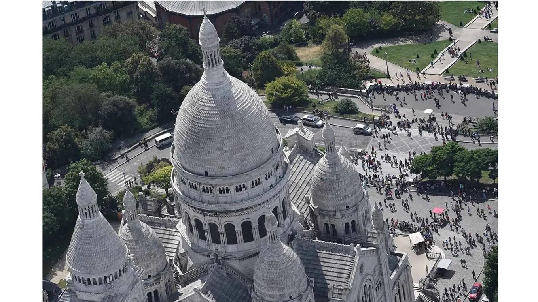 Las cúpulas de la Basílica del Sacré Cour foto: AFP Jean Sebastien Evrard