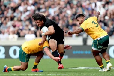 James Slipper and Taniela Tupou of Australia face Caleb Clarke of New Zealand during the second match of the Bledisloe Cup