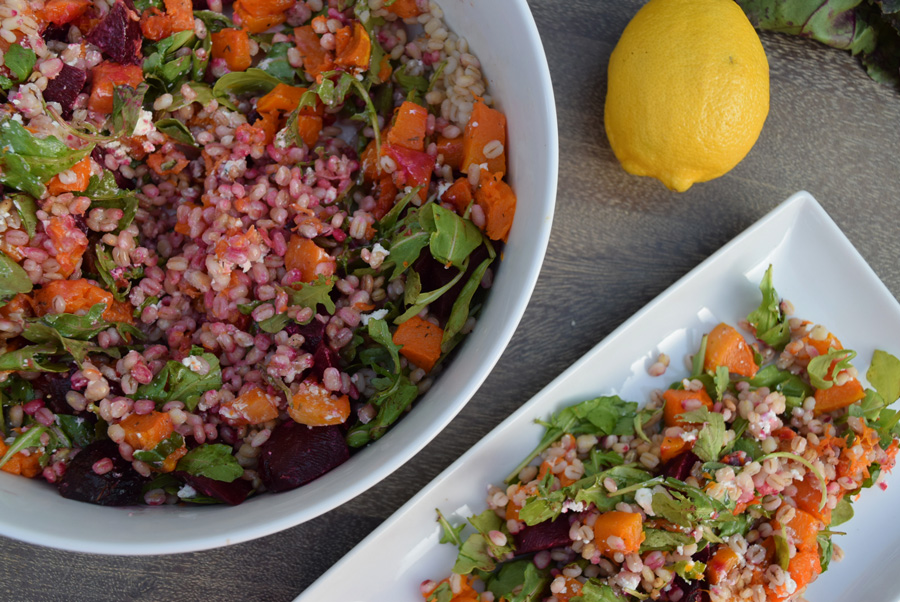 This healthy grain salad is the perfect combination of fall flavors, boasting bright colors and bold flavors from the combination of barley, roasted squash and beets with creamy goat cheese crumbles. Add it to your Thanksgiving dinner for a lightened up, nutritious side dish! | Thanksgiving side dish | Healthy salad