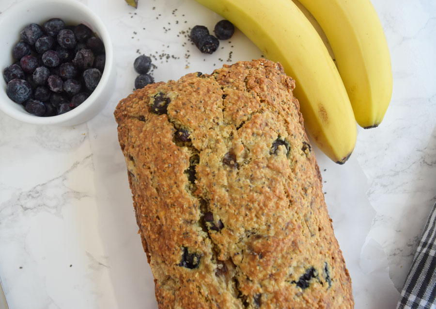 Blueberry Banana Chia Bread makes a great base for a sweet breakfast or on-the-go snack. Made with fruit, chia seeds, oat flour and half the sugar, it's a wholesome, healthy option for the whole family | Banana Blueberry Chia Bread