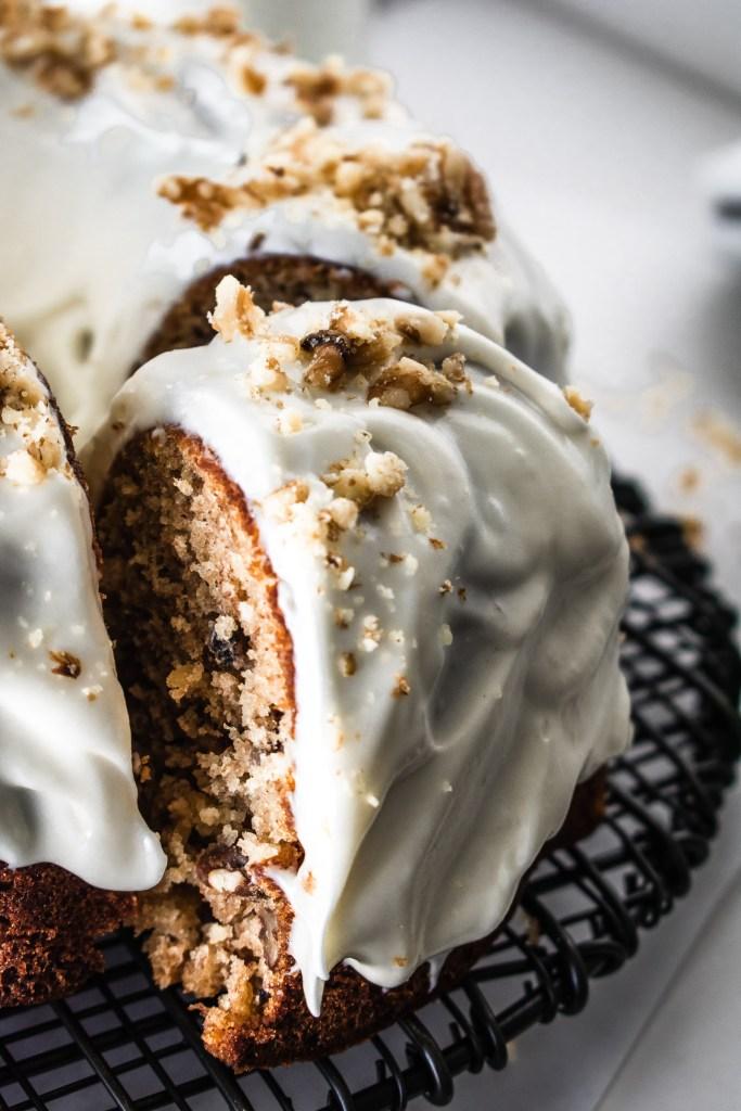 Cream cheese glaze on a hummingbird bundt cake