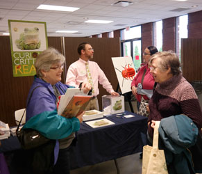 Authors speaks with fair attendees