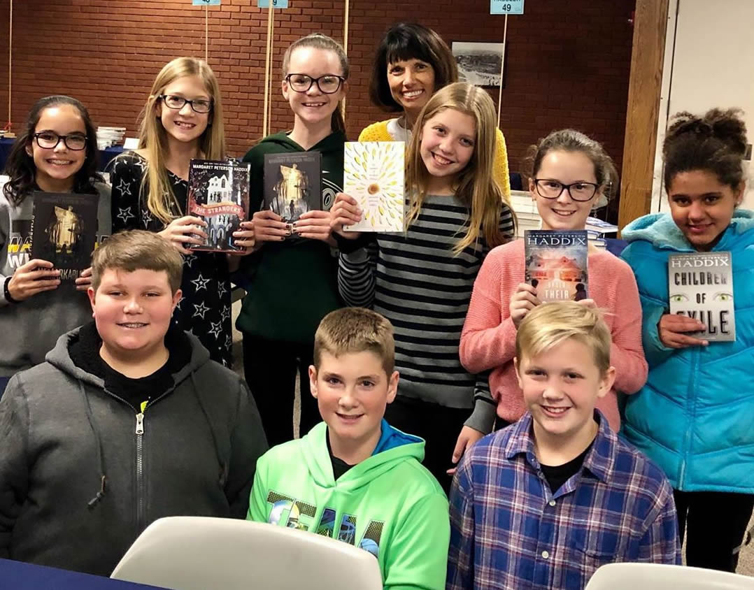 Young Authors holding books