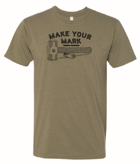 "moss green t-shirt shows artwork by Buckeye Engraving including steel hand stamp, hammer, and words ""Make Your Mark"" in curved, block text above hammer and Buckeye Engraving logo steel stamp hand drawn"