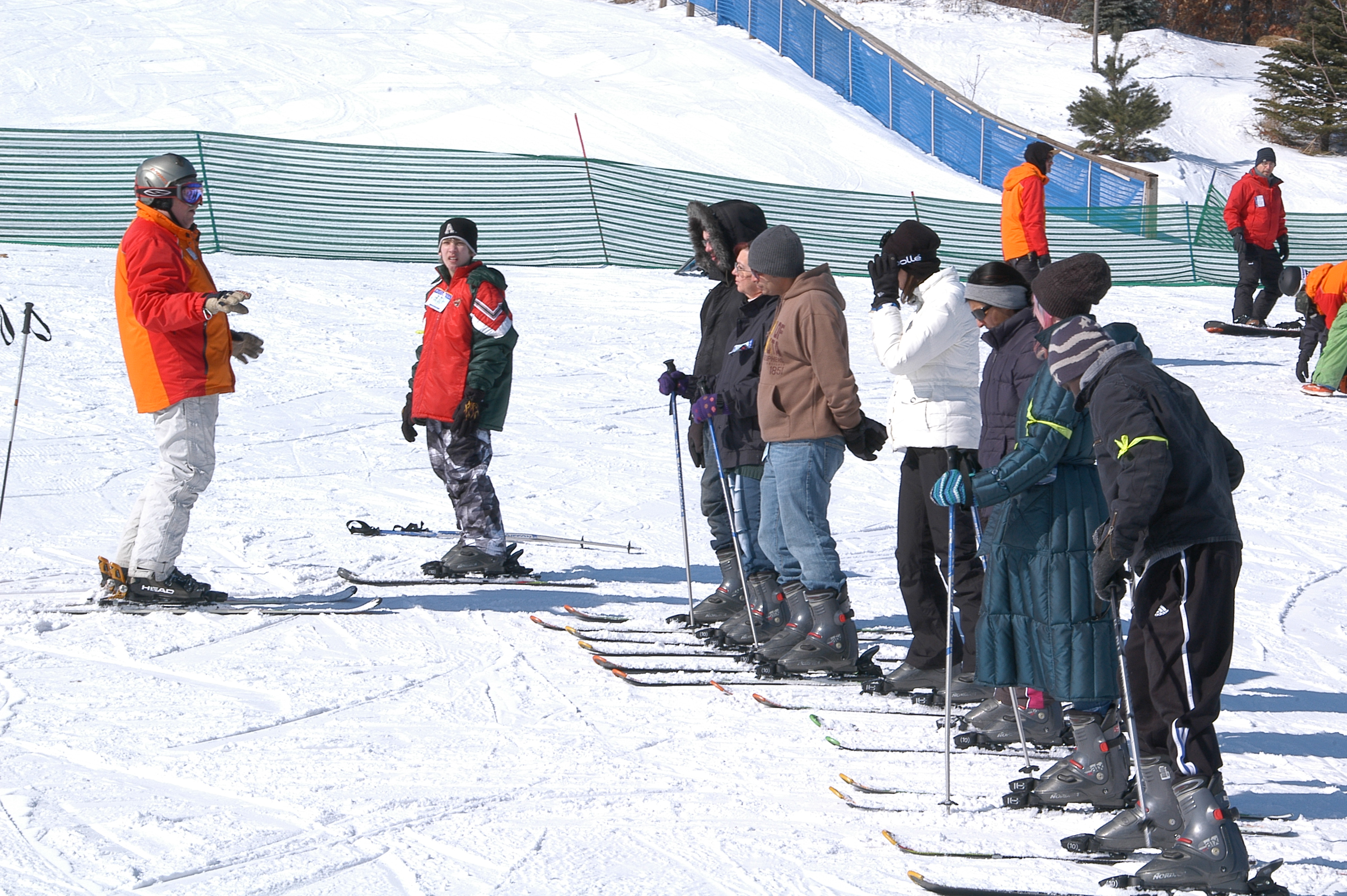 people skiing on hill