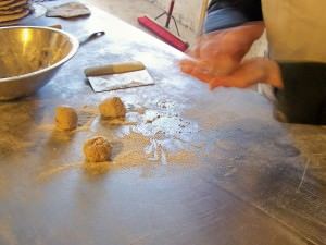 Making individual balls; photo by L. Goldman; baking matzah