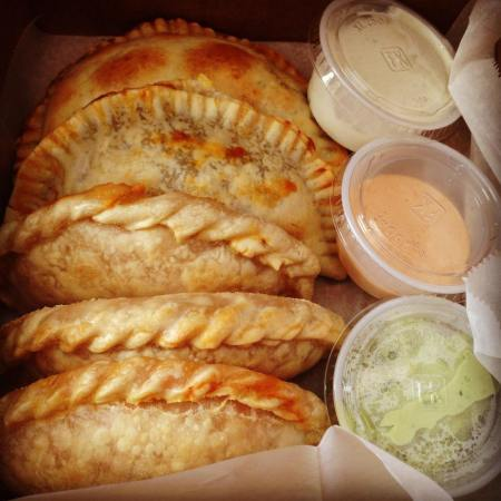 empanadas with sauces; photo courtesy of Empanada Mama